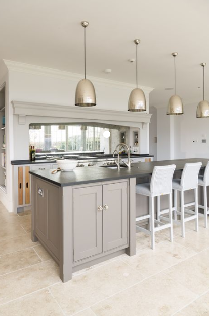 large kitchen island with metallic pendant lighting gray shaker cabinets and built-in sink