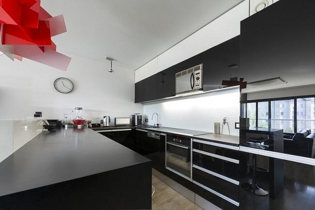 A large kitchen with stainless steel appliancesDescription automatically generated