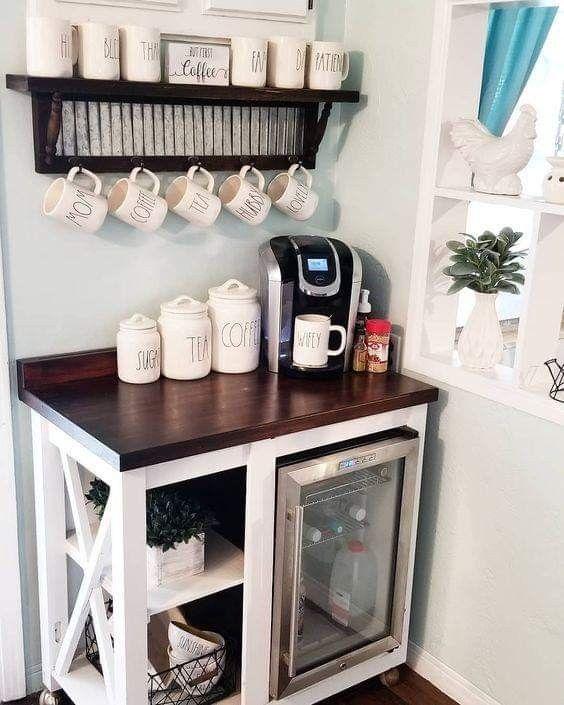 farmhouse coffee cabinet with fridge storage, black keurig, personalized coffee mugs and farmhouse decor