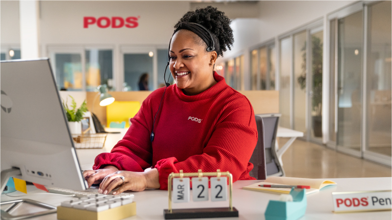 a PODS customer service representative helping a customer on the phone