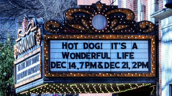 a movie theater marquee during the holidays