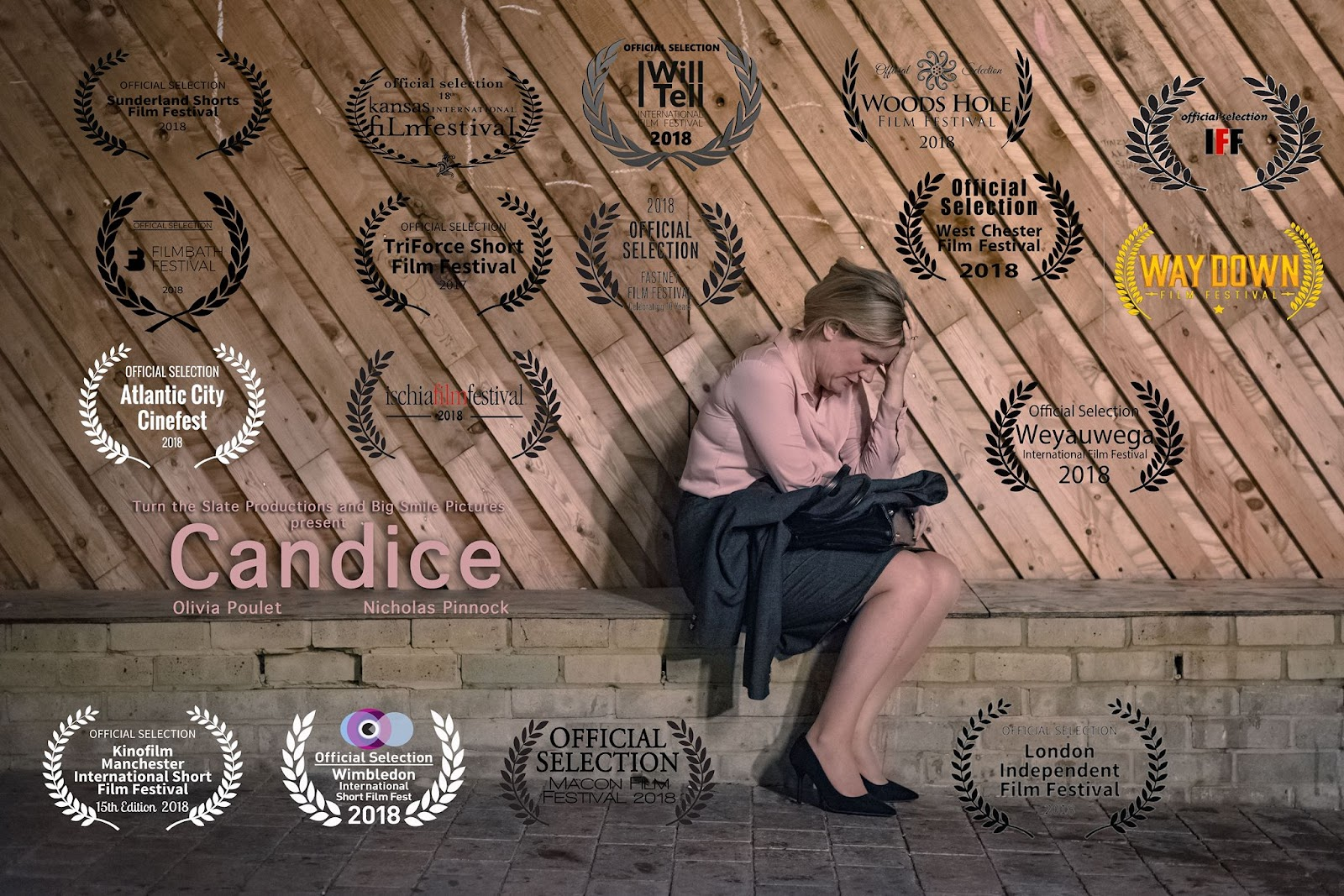 Advertising poster for short film 'Candice' (2017). A wide shot of a wooden fence, in front of which is a low brick wall. A blonde white woman (Candice) sits on the wall, hunched over with her head resting in her hand, making herself small.