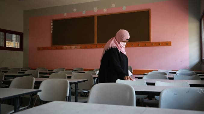 A worker cleans the classes to prepare the school before face-to-face teaching at certain classes on October 10, at Taybe Schools in Khan Yunis, Gaza on October 04, 2020.
