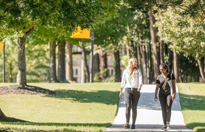 two women walking in a park in Brookhaven, GA