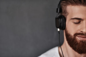 young man listening to music image