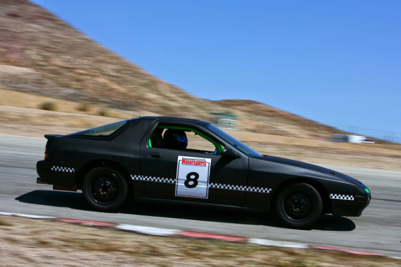 Paul Walker at a race track racing - NoPistons -Mazda Rx7 & Rx8