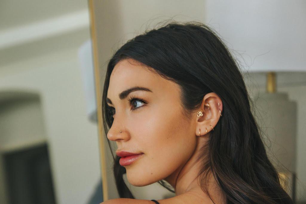 Woman with multiple ear piercings