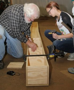 Ray Leising works with Kaylee McCoy, an eighth-grader at Jonesville Middle School.
