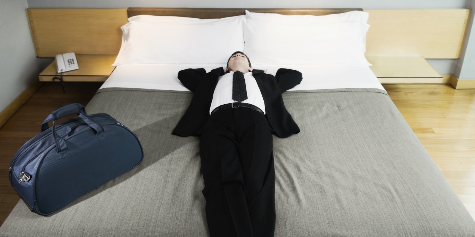 Man Lying Down In Hotel