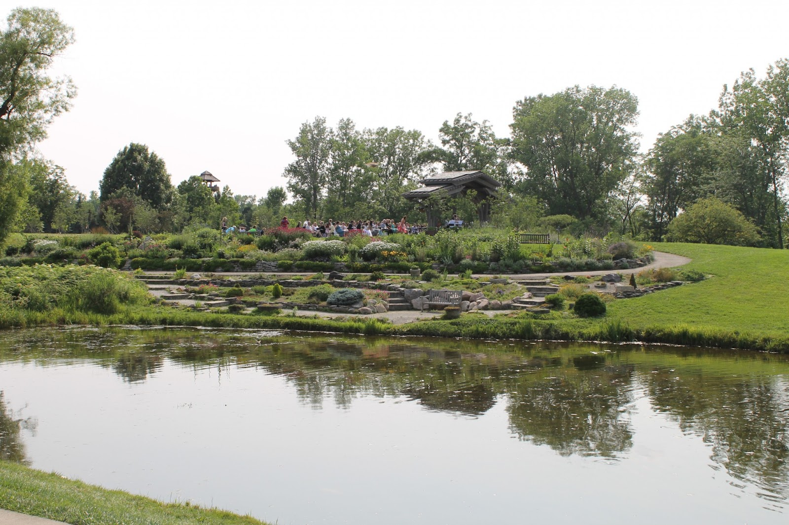 a pond, stone path, and flowers at Cox Arboretum