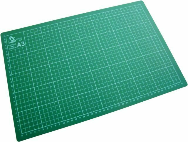 A green A3 cutting mat with measuring grid