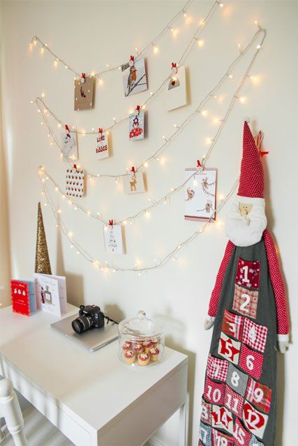Christmas Light Card Holder: These 25 DIY Christmas Card Holders - That Double As Festive Decor will allow you to beautifuly display your cards and will also give you some great decor.