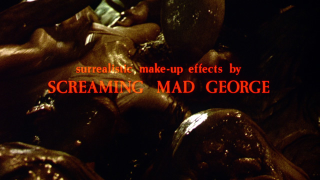 "Society (1989). An on-screen credit in red text that says ""surrealistic makeup effects by SCREAMING MAD GEORGE"""