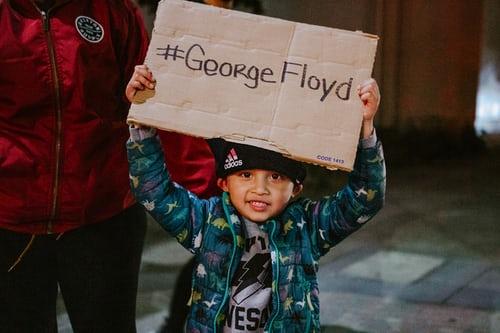 Kid with george floyd board