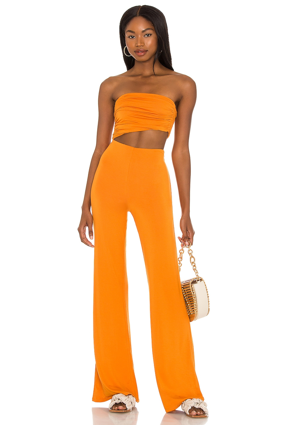 The orange jumpsuit perfect for your night out is one of the top-10 best -fashion gift-ideas for women.