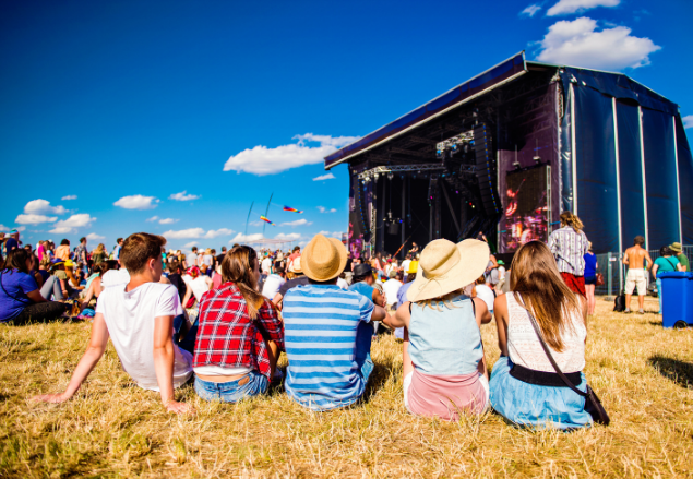 people sitting down at a music festival