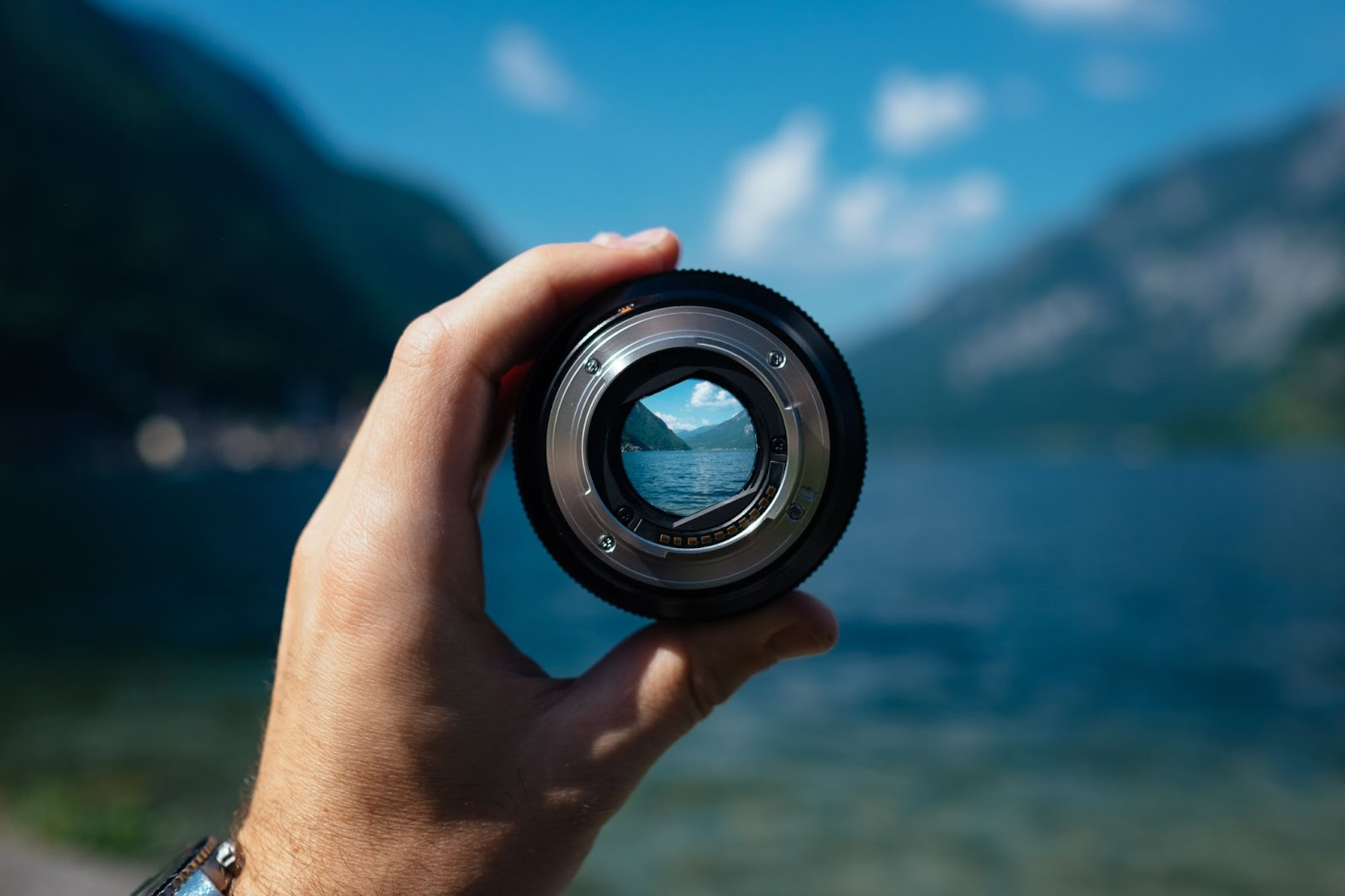 Photo of a lake seen through camera lens made by a professional photographer.