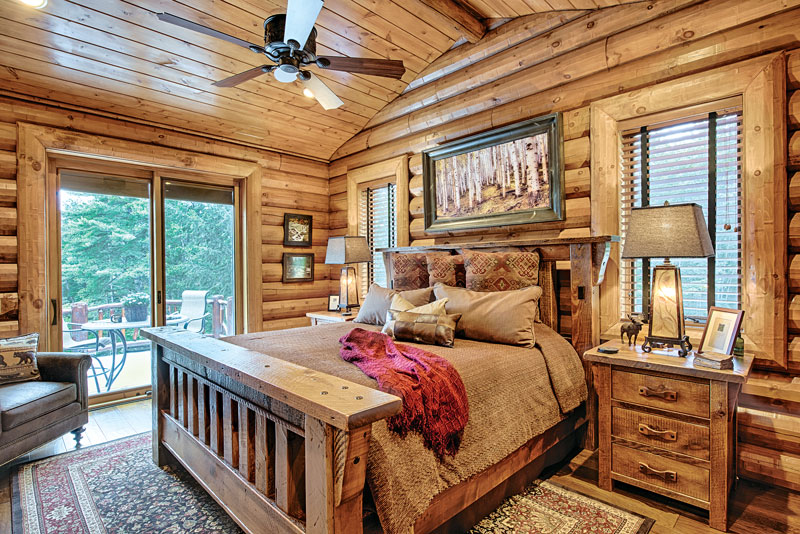wooden themed bedroom: using wood logs throughout the room