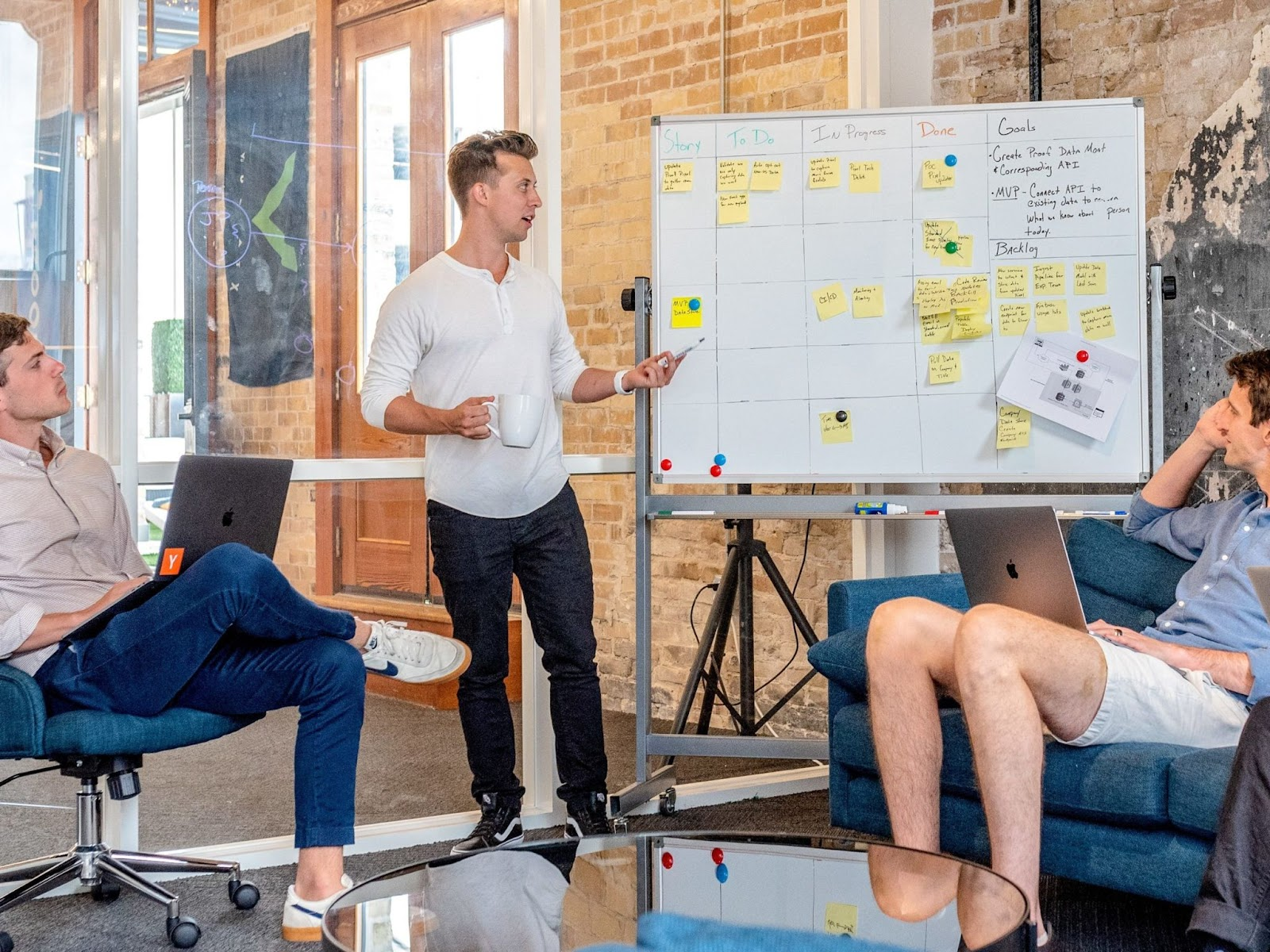 Discussing go-to-market strategy on a drawing board