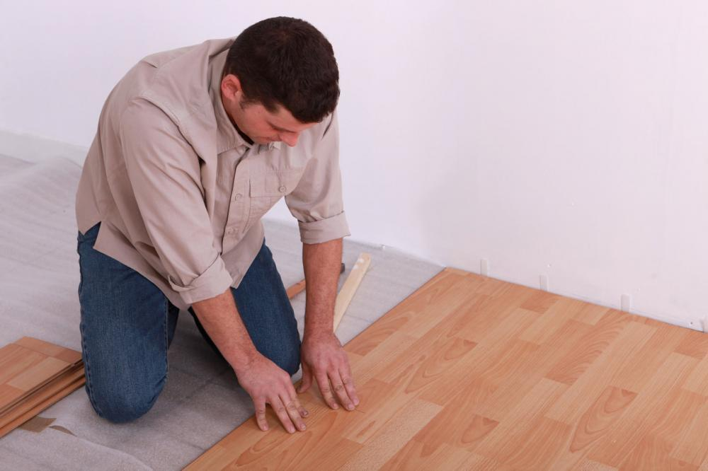 http://streaming.yayimages.com/images/photographer/phovoir/cc0f7ea64e90a782690ea1ff379a3dcc/man-laying-a-wooden-floor.jpg