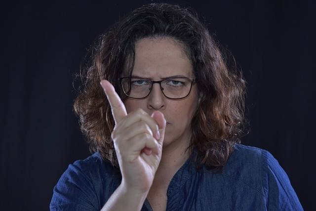a woman looks angry and wags her finger