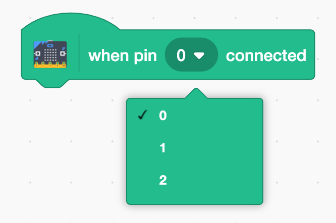 """This is the Scratch block to use with the micro:bit pins. It is shorthand for """"When pin 0 is connected to GND (ground)"""". You can use the dropdown menu to select which pin you'd like to control, or use multiple blocks to control multiple pins! This functionality is similar to the"""