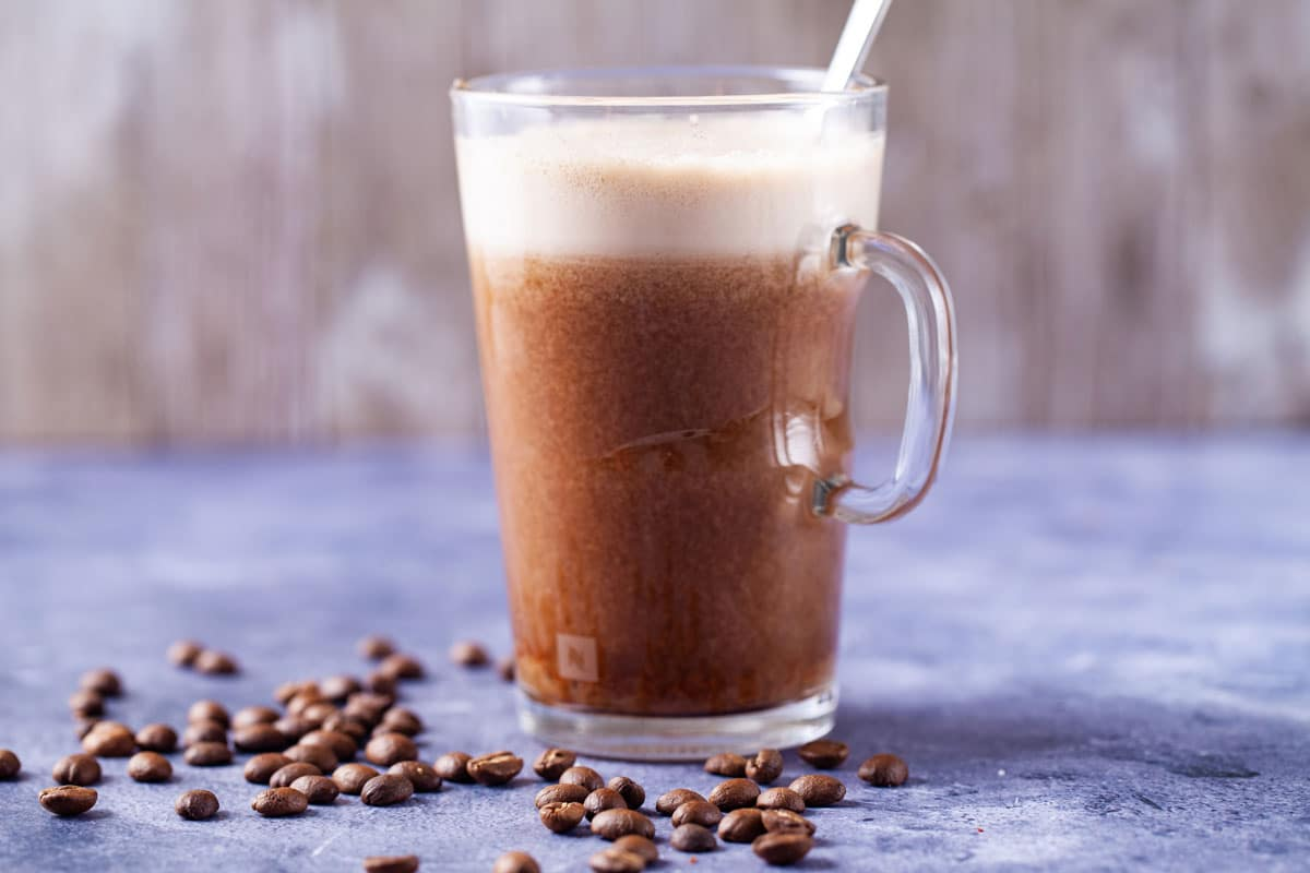 Glass mug with date-sweetened iced latte coffee drink
