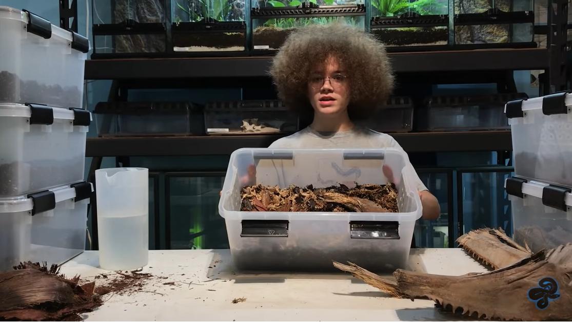 Daniel Carter holding completed isopod breeding habitat