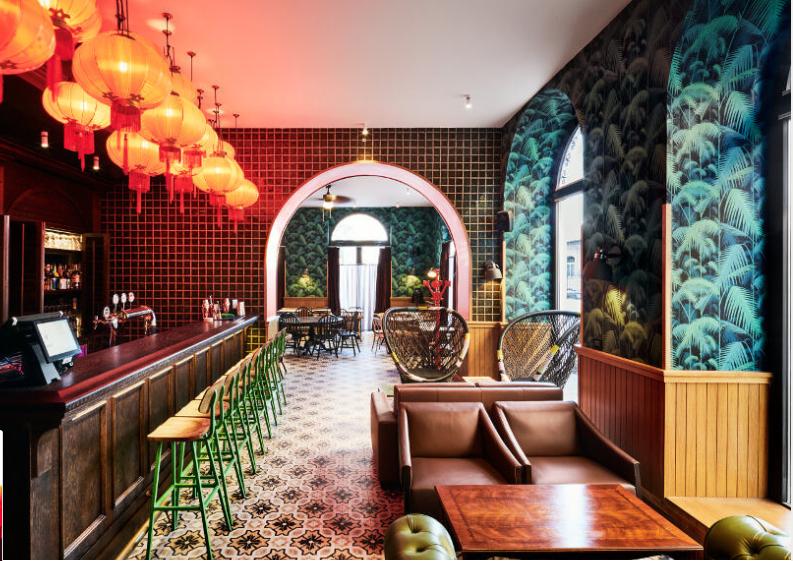 Hotel bar, bright oranges and blues, Stone flooring, unique interiors