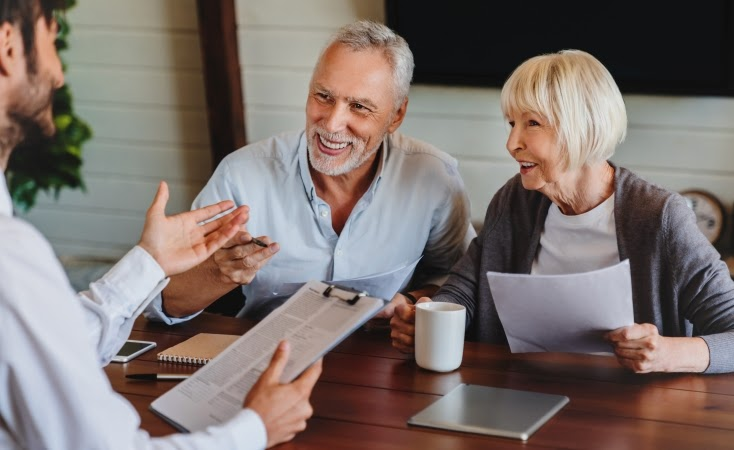 older couple discussing storm insurance with an agent