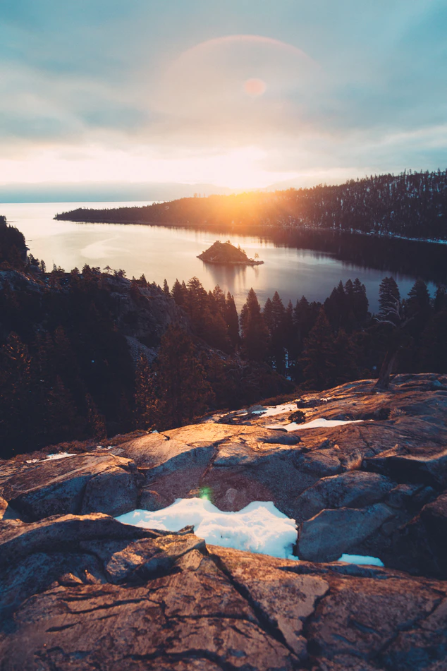 lake and mountain with lens flare