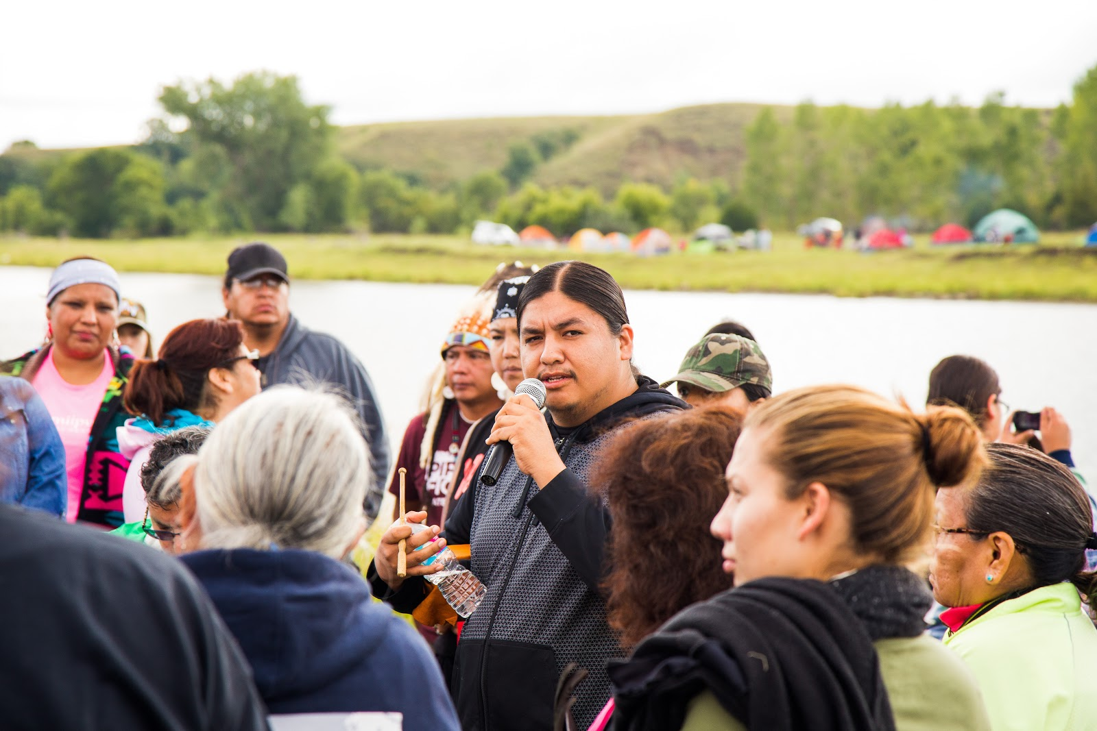 A member of the Haudenosaunee delegation explains the Confederacy's water blessing. (Photo: Alex Hamer)
