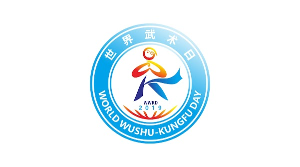 """This logo depicts a stick figure giving the """"palm-fist salute"""" and calling to mind the English letters """"WK"""" for the name of the holiday, """"World Wushu-Kungfu Day."""" Taiji imagery appears in the figure's head,  with a """"W"""" making up the """"palm-fist salute""""; a """"K"""" for """"kungfu"""" composed of straight block graphics, calling to mind the clothing of an ancient warrior, symbolizing modern wushu's ancient and traditional origins; embedded within the figure is the essence of """"World Wushu-Kungfu Day."""" The figure stands on the earth, demonstrating wushu enthusiasts' beautiful displays of wushu all over the world. The lines are both free curves and straight lines, symbolizing the perfect unity of the world's wushu, the combination of strength and flexibility, skill and strength."""
