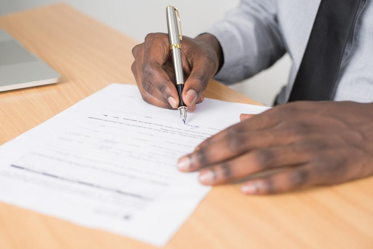 A man filling out paperwork