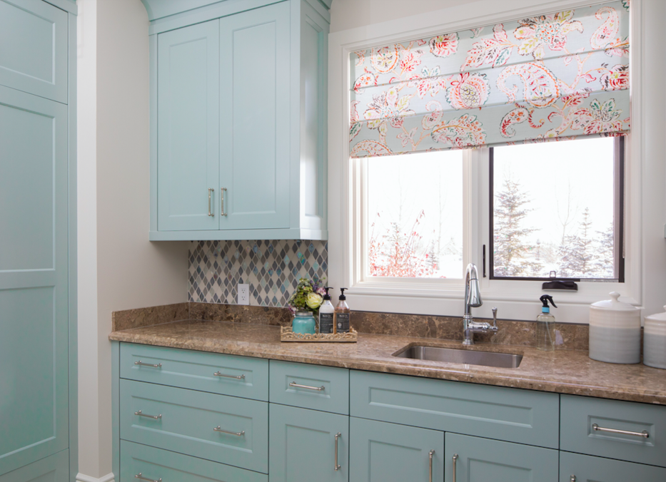 fresh laundry room with backsplash and colorful roman shades in calgary