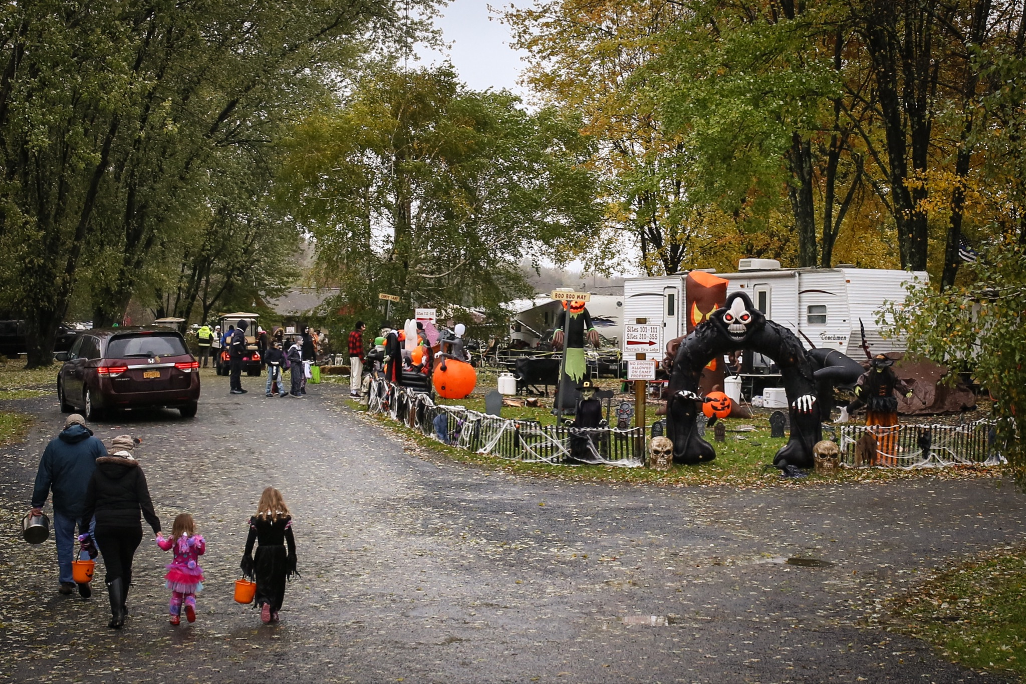 Trick-or-treat at campground with campsite decorated for halloween.
