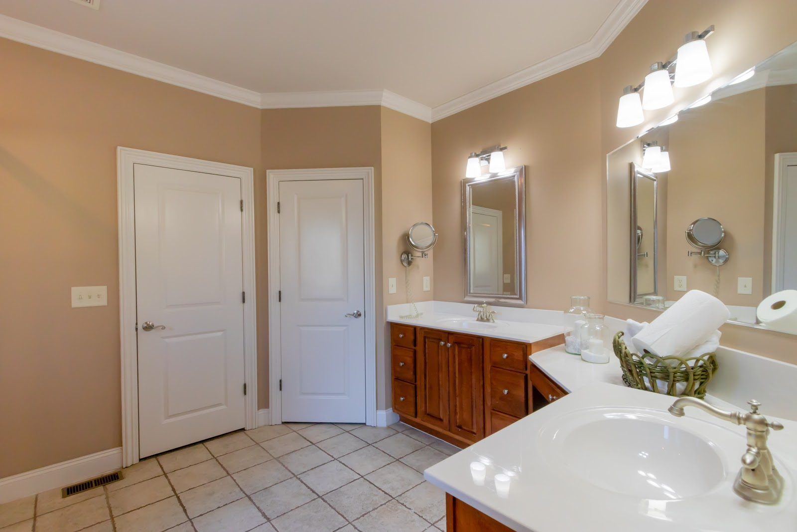 You can place a few non-bulky items on the master bathroom counters if you don't want to leave them bare when staging.