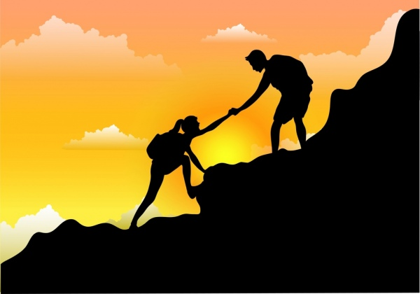 A person helping another up a mountain