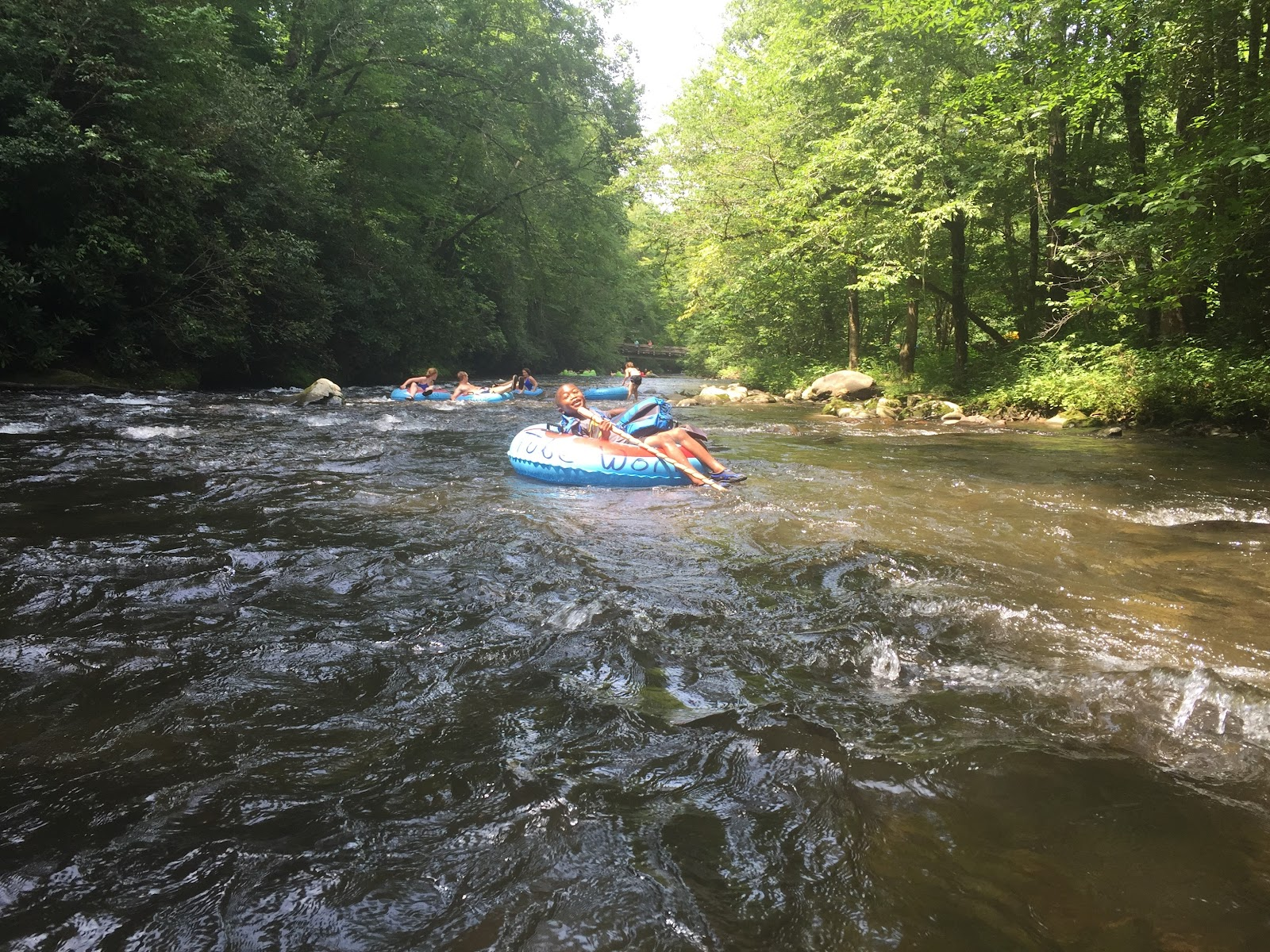Group of people white water rafting in the Great Smoky Mountains