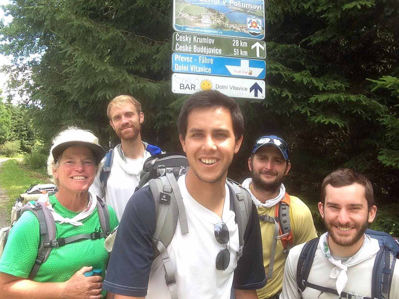 Taking a break on a road in Czech Republic, a group making a walking pilgrimage from Rome to Krakow, Poland, in time for World Youth Day includes (from left) Ann Sieben, Nick Zimmerman, Rafael Maturo, Ricardo Simmonds and Andrew Dierkes.