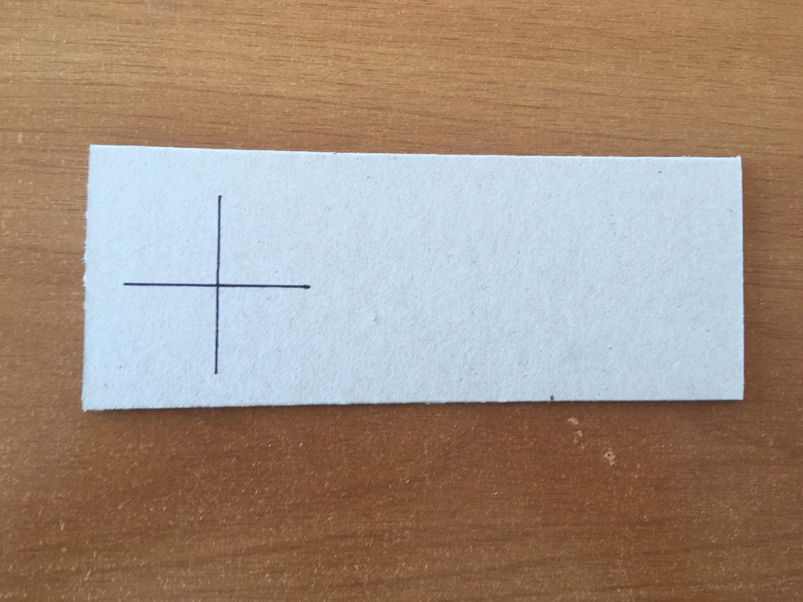 Trazado de dos líneas rectas compartiendo su punto medio, formando una cruz.