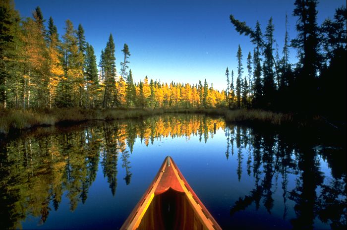 A canoe on a still lake.