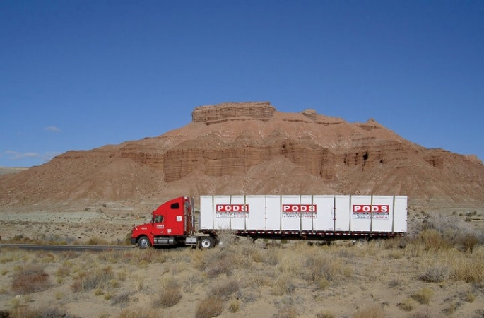 PODS truck shipping multiple portable storage containers