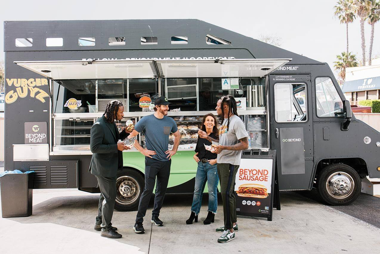 beyond meat sausage human standing in front the food car
