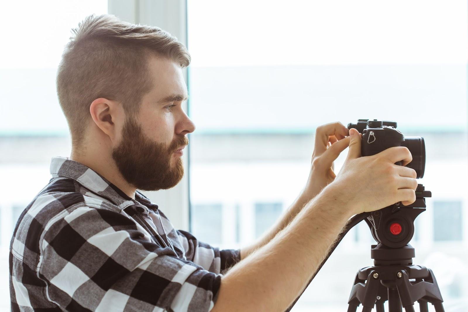 man setting up video recording equipment