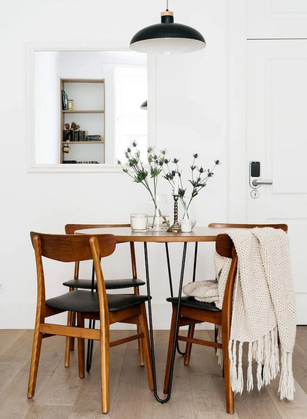 minimalist scandinavian dining room with wood dining furniture and white wall paint