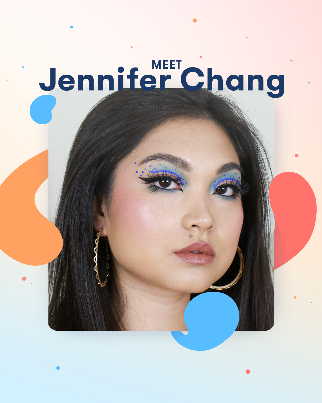 Close up of Jennifer Chang with detailed, spotted blue eye makeup, thick winger eye liner and long false lashes.