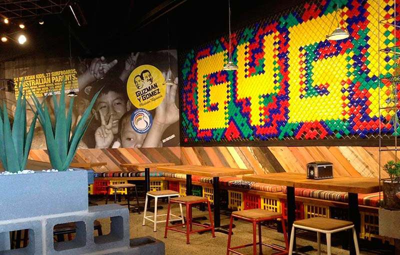 Each Guzman Y Gomez store features a unique wall graphic that reinforces their brand heritage and purpose.