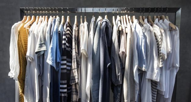 assorted shirts and sweaters in hangers