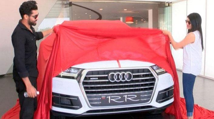 Ravindra Jadeja and his wife revealing the Audi Q7
